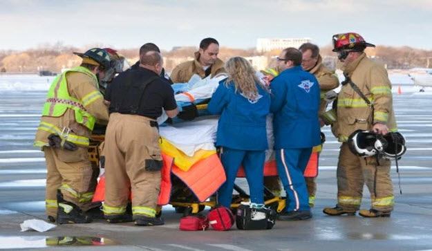Firefighters and Paramedics treating patient