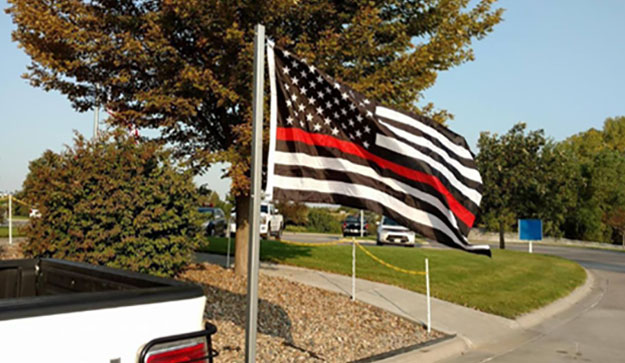 Hospital Orders Firefighter to Remove 911 Memorial Flag from His Truck