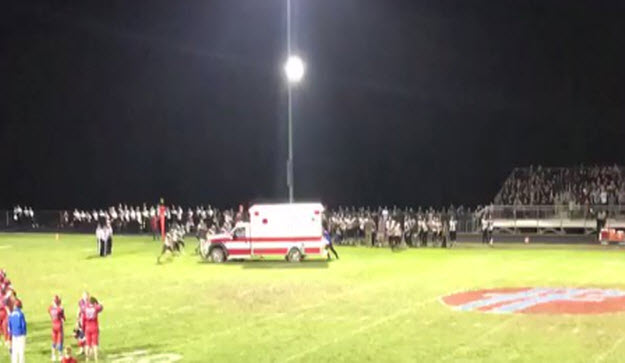 Video: High School Football Team 'Saves' Ambulance — Pushes it off field