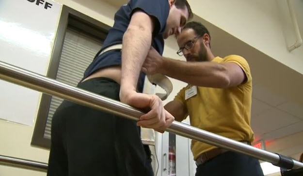 Paralyzed EMT Learns to Walk Again