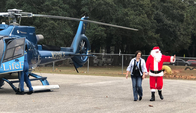 Santa Visits School Christmas Party By Helicopter