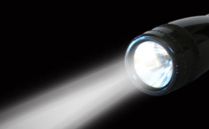 Man Charged After Blinding Helicopter Pilot with Flashlight
