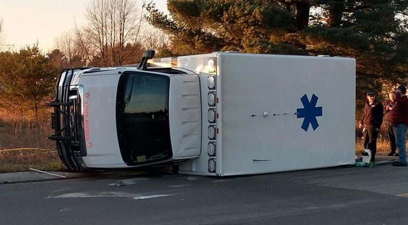 MANISTEE COUNTY, Mich. (WPBN/WGTU) -- A semi hauling logs crashed into a North Flight EMS ambulance Saturday afternoon, according to the Manistee County Sheriff's Office.