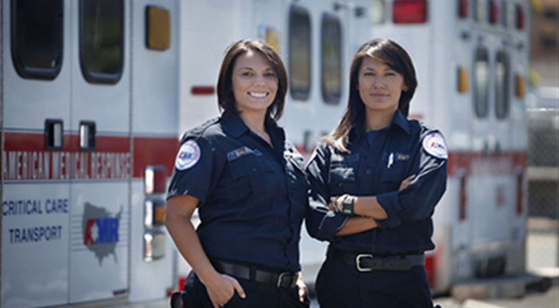 EMTs in front of Ambulance